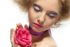 Beautiful young woman with a flower. Stock Photo