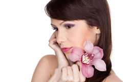 Beautiful young woman with a flower. Stock Photography
