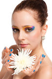 Beautiful young woman with a flower. Royalty Free Stock Photography