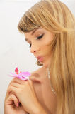 Beautiful young woman with flower. Beautiful young woman with violet flower Stock Photography