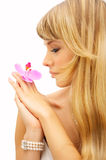 Beautiful young woman with flower. And long blond hair Stock Photos