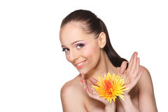 Beautiful young woman with a flower. Royalty Free Stock Photo