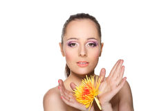 Beautiful young woman with a flower. Royalty Free Stock Images