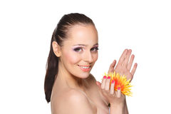 Beautiful young woman with a flower. Stock Images