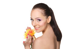 Beautiful young woman with a flower. Royalty Free Stock Image