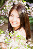 Beautiful young woman on flower background Royalty Free Stock Photos