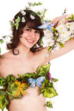 Beautiful young woman with flower and butterfly. Stock Photography