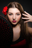 Beautiful young woman with flower Royalty Free Stock Image