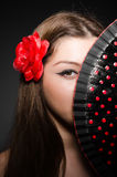 Beautiful young woman with flower Stock Image