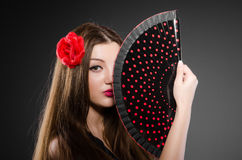 Beautiful young woman with flower Stock Photos