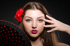 Beautiful young woman with flower Stock Photo