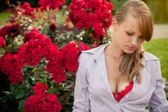 Beautiful young woman in flower garden Royalty Free Stock Photos