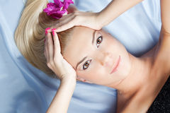 Beautiful young woman with flower in hair Royalty Free Stock Images