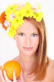 Beautiful young woman in flower hat Royalty Free Stock Images