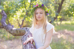 Beautiful young woman in flower wreath Royalty Free Stock Image