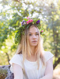 Beautiful young woman in flower wreath Stock Photo