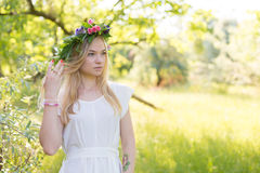 Beautiful young woman in flower wreath Stock Images