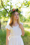 Beautiful young woman in flower wreath Stock Photography