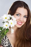 Beautiful young woman with flowers Stock Photos