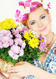 Beautiful young woman with a flowers basket Royalty Free Stock Images