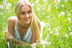 Beautiful young woman among the flowers Stock Photo