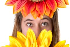 Beautiful young woman with flowers Stock Images