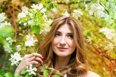 Beautiful young woman with flowers. Stock Photos