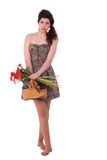 Beautiful young woman, with with flowers and boots Royalty Free Stock Photography