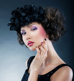 Beautiful young woman with flowers - bright makeup Stock Photography