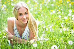 Beautiful young woman among the flowers Stock Photos