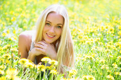 Beautiful young woman among the flowers Stock Photography