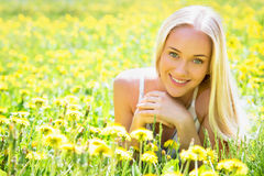 Beautiful young woman among the flowers Royalty Free Stock Photo