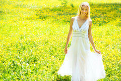 Beautiful young woman among the flowers Royalty Free Stock Images