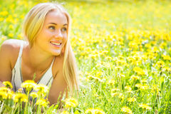 Beautiful young woman among the flowers Royalty Free Stock Photography