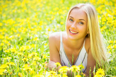 Beautiful young woman among the flowers Royalty Free Stock Photos