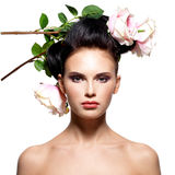 Beautiful young woman with flowers in hair. Royalty Free Stock Photo