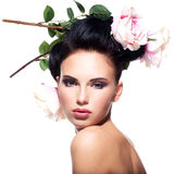 Beautiful young woman with flowers in hair. Royalty Free Stock Photography