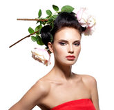 Beautiful young woman with flowers in hair. Stock Photography