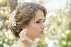Beautiful young woman with flowers in hair Royalty Free Stock Images