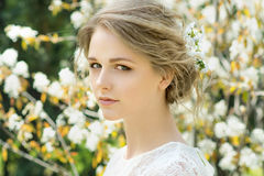 Beautiful young woman with flowers in hair Stock Photography