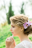 Beautiful young woman with flowers in hair Royalty Free Stock Photos
