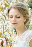 Beautiful young woman with flowers in hair Royalty Free Stock Image