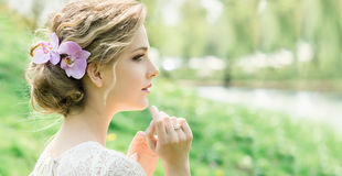 Beautiful young woman with flowers in hair Royalty Free Stock Photo
