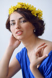 Beautiful young woman with flowers in her hair Royalty Free Stock Image