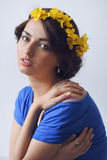Beautiful young woman with flowers in her hair Stock Photo