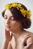 Beautiful young woman with flowers in her hair Stock Photography