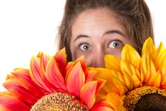 Beautiful young woman with flowers Stock Image