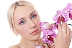Beautiful young woman with flowers of orchid Royalty Free Stock Photo