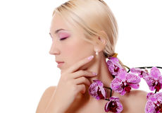The beautiful young woman with flowers of orchid Stock Photography