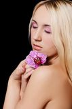 The beautiful young woman with flowers of orchid Stock Image